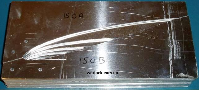 Airfoil cross sectons are cut out of aluminium sheet. They are shown over-layed from smallest to largest in order of their position along the wing.