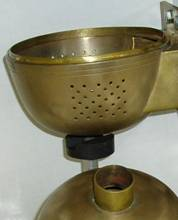 The entire vessel is made from brass and the bottom hemisphere has an inside lip that allows both halves to be pushed together to make perfect electrical contact. A motorized soft iron magnet is used beneath the bottom hemisphere to stir the teflon magnet inside the reaction vessel.