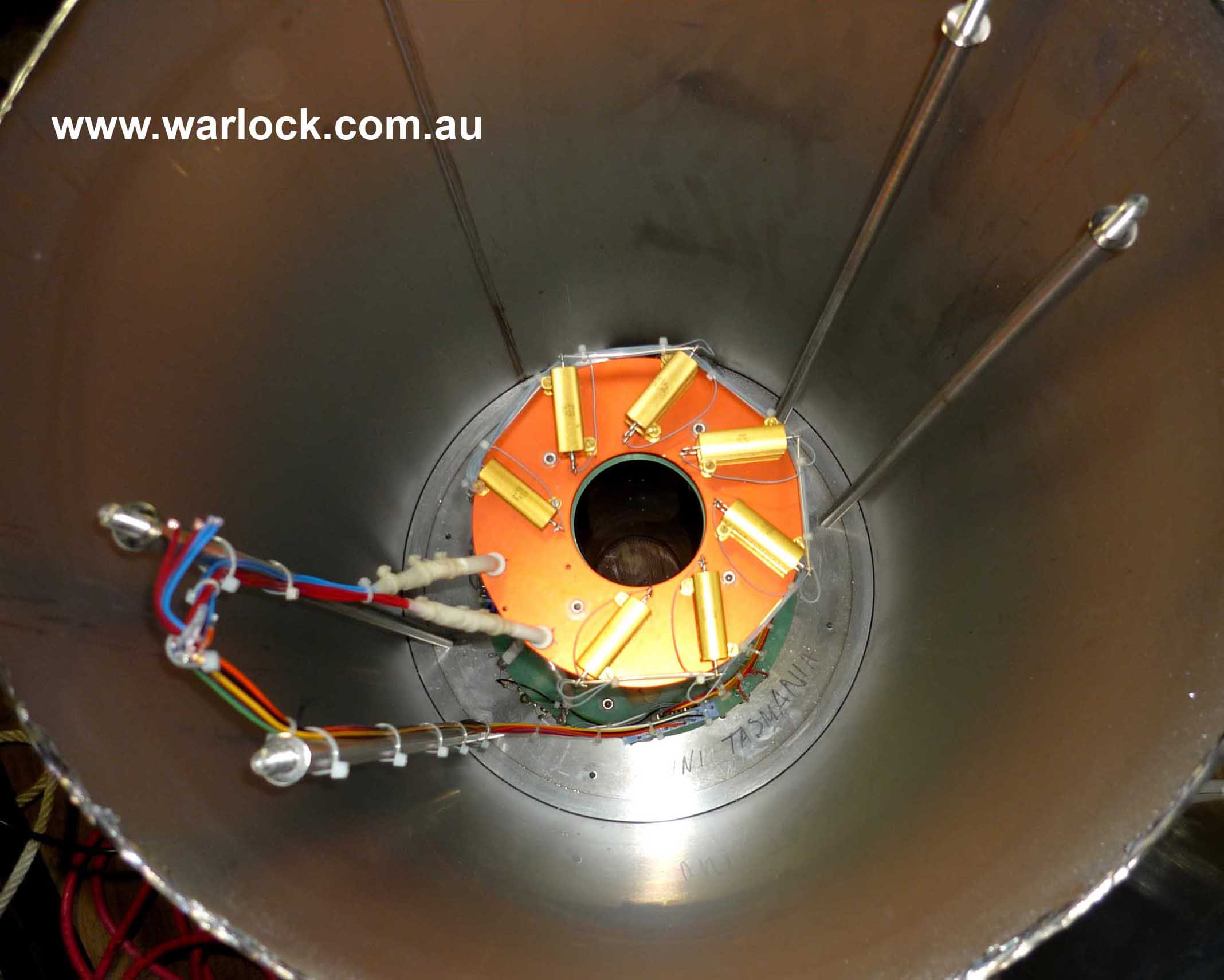 The superconducting magnet as viewed from the top of the helium vessel